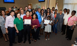 Group photo of Sunrise's 2015 scholarship winners with their families and the City Commission