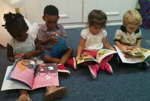Preschool children reading books