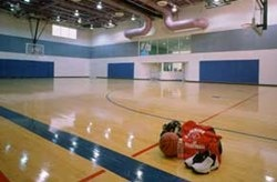 The gymnasium has hardwood floors and retractable seating