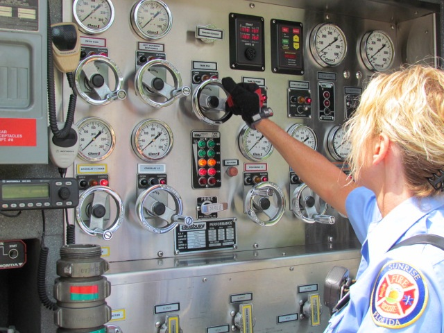Driver/Operator at the controls of the Pump Panel on the Engine