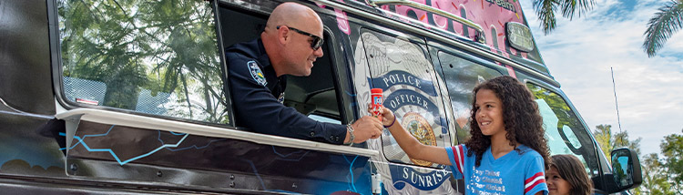 Police Giving Ice Cream To Children